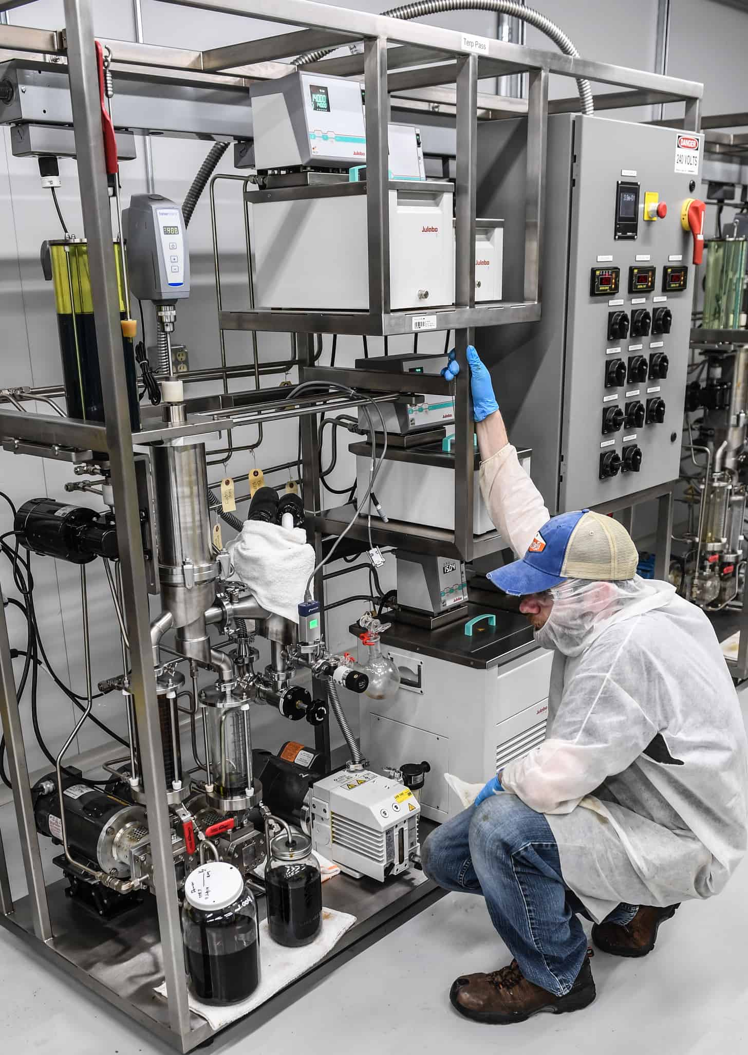 Man in PPE operating extraction equipment